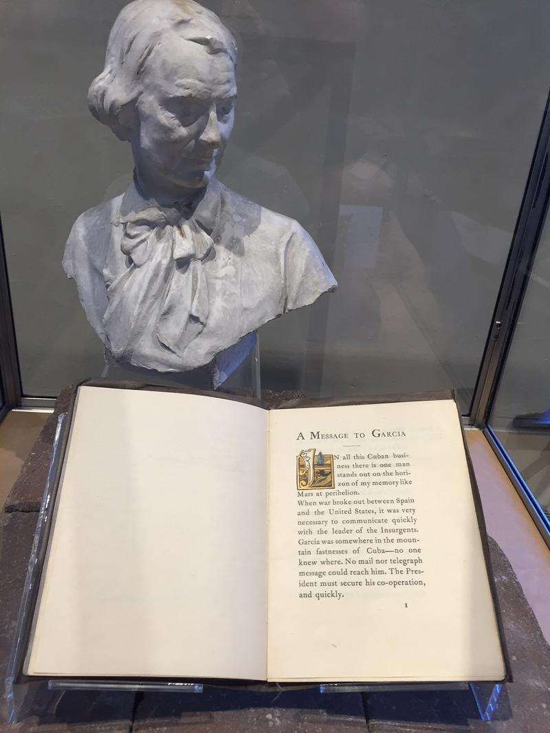 A small bust of Elbert Hubbard, founder of the Roycroft Campus, and a copy of his work A Message to Garcia