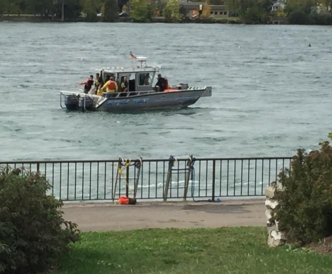 A Buffalo Police boat searches the water for a missing diver who disappeared during a Police training exercise.