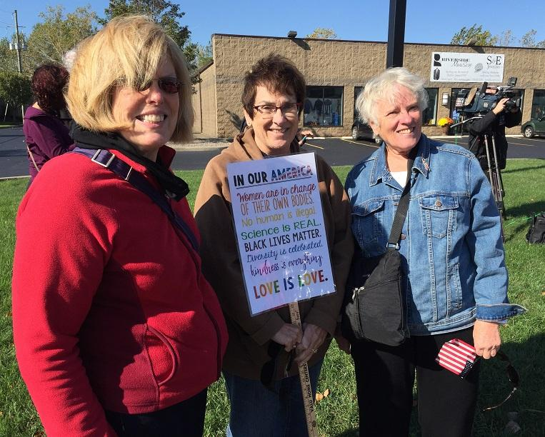 Eileen Giarraffa (center) and her colleagues arrive to protest Vice President Mike Pence's visit to suburban Buffalo on Tuesday.