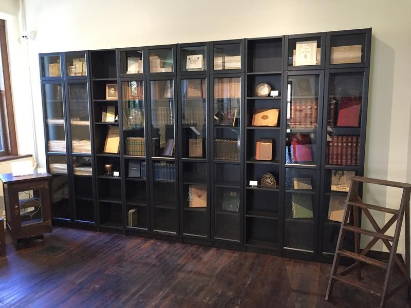 A bookshelf facing opposite the fireplace inside the Roycroft Museum.