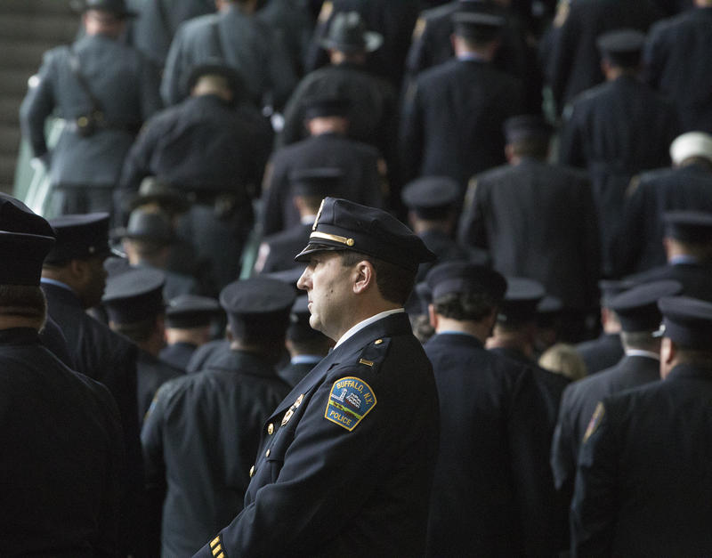 Police officers entering KeyBank Center