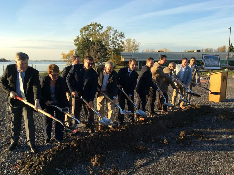 Officials break ground on the new River's Edge housing complex.