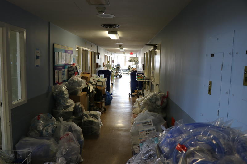 As patients moved out of the various wings of the hospital, staff and volunteers continued to work, packaging up supplies for transport.