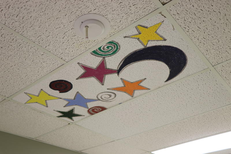 In one hallway of the hospital, ceiling tiles were painted by pediatric patients. Now that the hospital is vacated, the ceiling tiles are reportedly in high demand by parents.