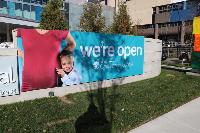 Signs outside the new Oishei Children's Hospital on the Buffalo Niagara Medical Campus proclaim its open for business.