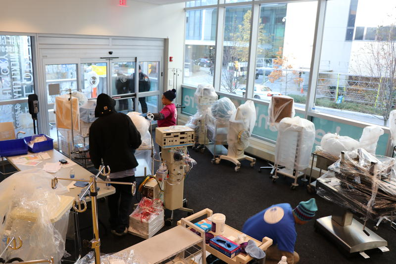 Staff accept equipment from Women & Children's into Oishei Children's Hospital.