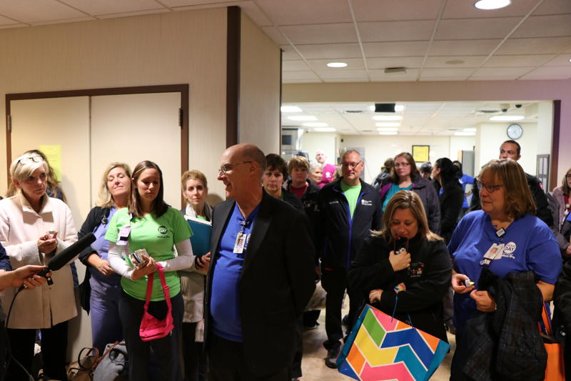 Staff gather for a final prayer in the cafeteria of Women & Children's Hospital before making their final goodbye to the building.