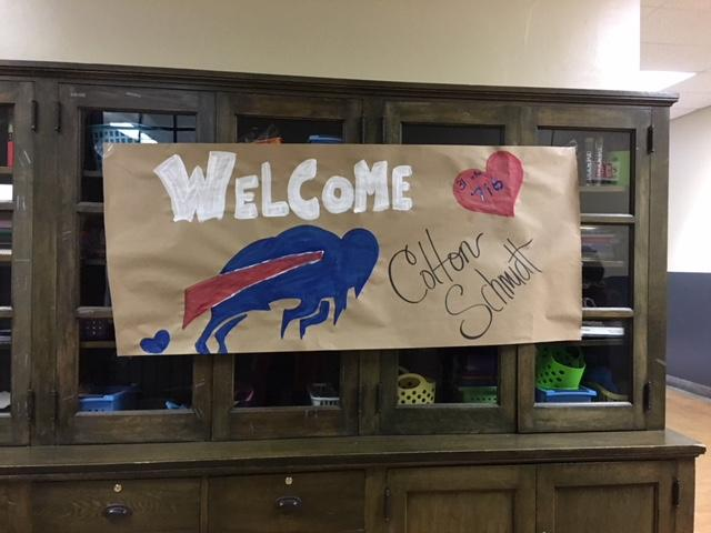 Students created a welcome sign for the Bills punter.