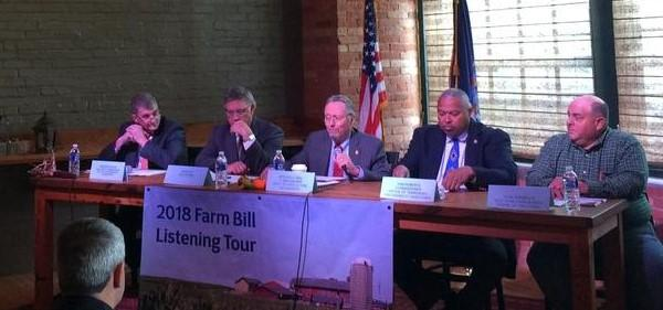 New York Agriculture Commissioner Richard Ball (center) is traveling the state, asking for comment.