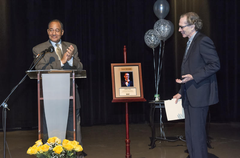 Anthony Chase was awarded a plaque for the WBFO studio by President and CEO Don Boswell
