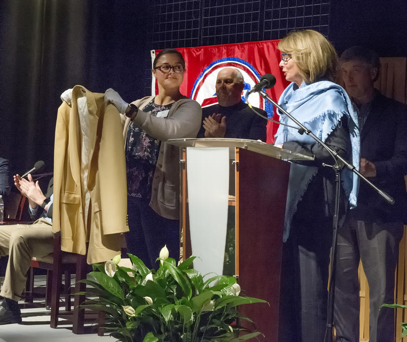 Mary Wilson presents Ralph C. Wilson Jr.'s Pro Football Hall of Fame jacket to the Buffalo History Museum for display during their upcoming ICONS exhibit