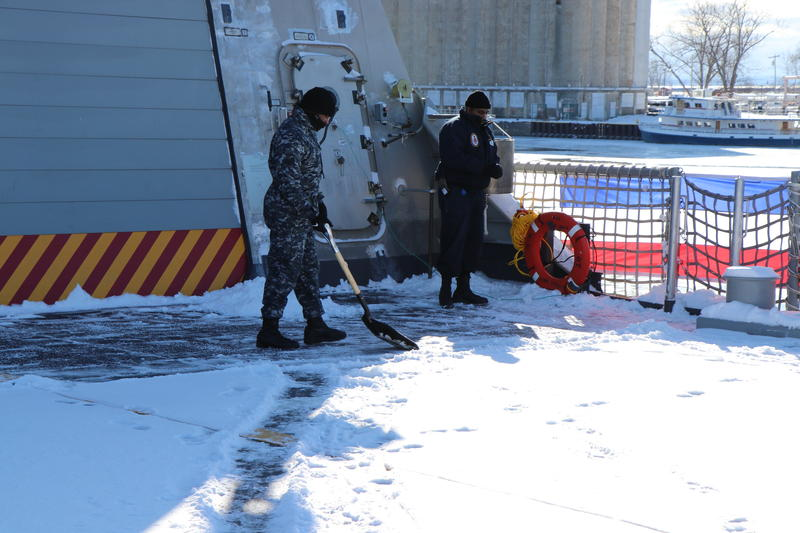 Sailors aboard the USS Little Rock don't escape the Buffalo tradition of shoveling snow.