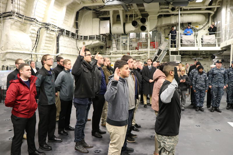 18 Western New Yorkers enlisted into the various branches of the armed forces aboard the new USS Little Rock on Thursday.