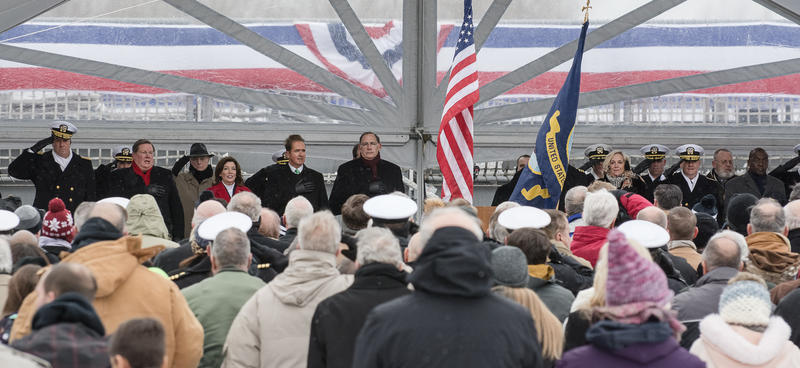 Members of the official party sit on the dais during the commissioning of the new USS Little Rock.