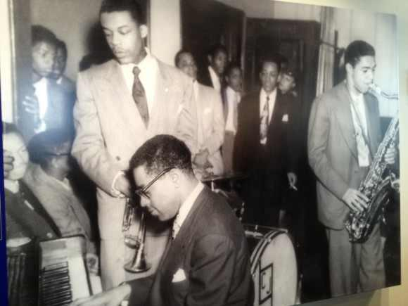 Dizzy Gillespie at piano at the CMC next to Elvin Sheppard and Wilbur Trammel on Tenor with John Coltrane and Miles Davis in background