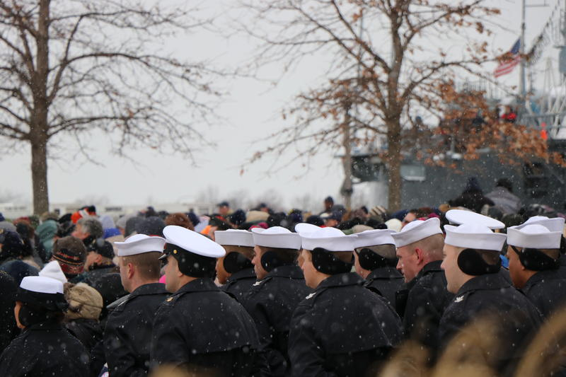 Sailors of the new USS Little Rock brave the cold and snow.