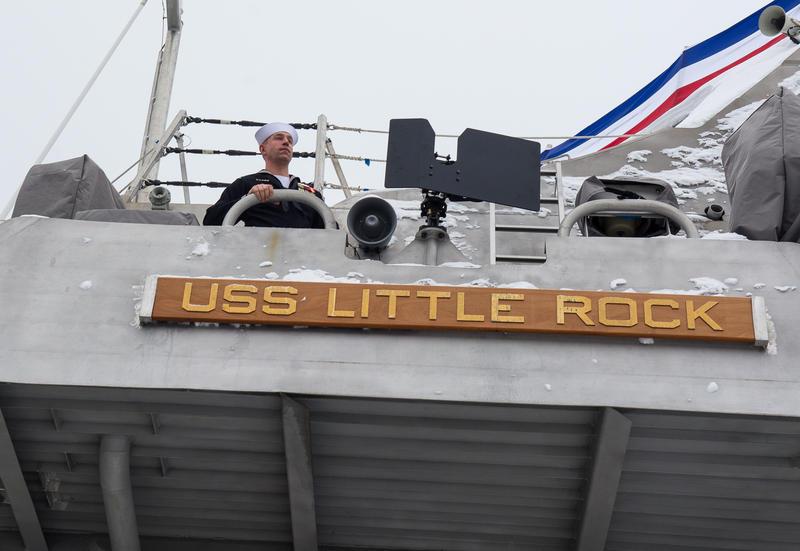 A sailor aboard the USS Little Rock.