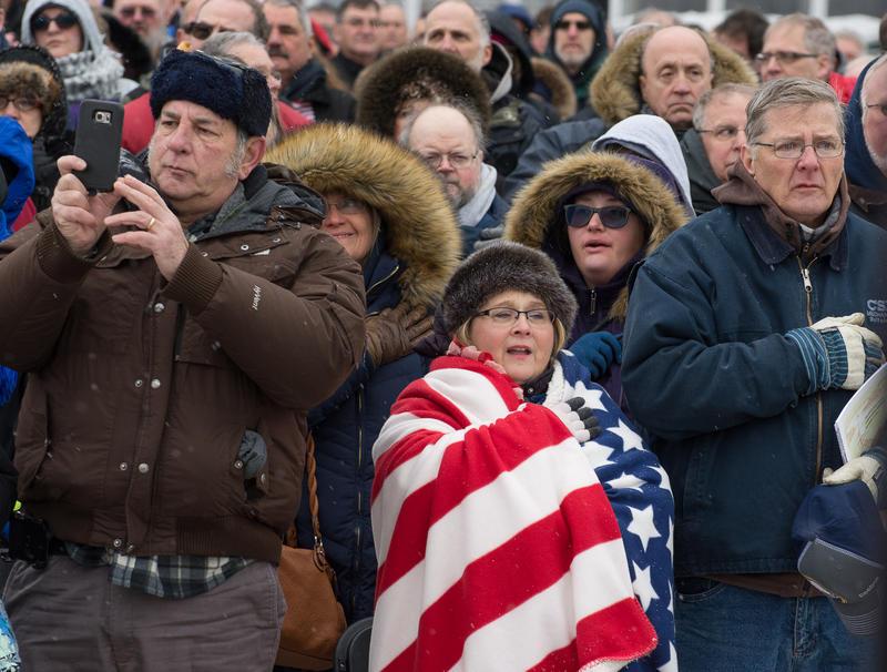 Lori Gondek of Getzville keeps warm in a flag blanket.