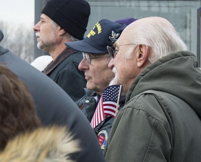 John Radens and John Wilczynski watch as the new USS Little Rock passes the original decommissioned vessel of the same name. Veterans were among the hundreds of people who came to watch the new Little Rock's arrival.