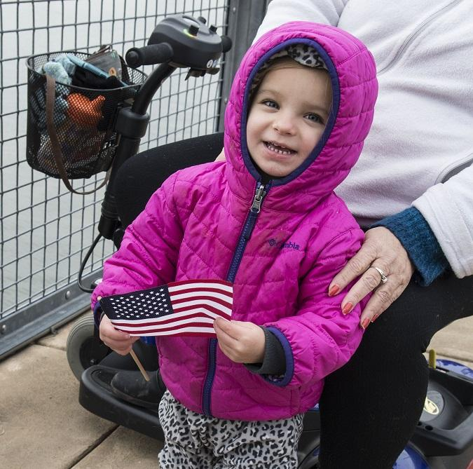 Two-year-old Kasey Antonucci was among the civilians waving small flags and greeting the new USS Little Rock as it arrived in Buffalo Monday morning.