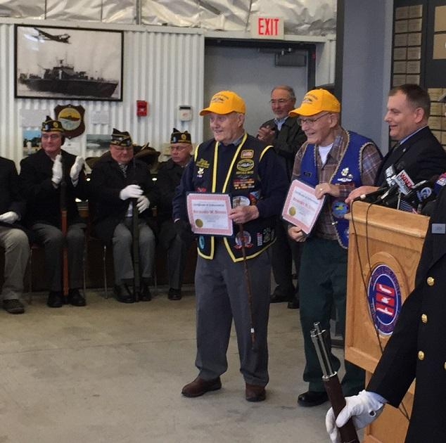 Dick Bondi (left) and Robert Stoll are honored for their service aboard submarines during World War II.