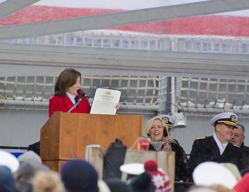 New York Lieutenant Governor Kathy Hochul shows a proclamation by the Governor, which she chose not to read in favor of speeding up the frigidly cold commssioning ceremony.
