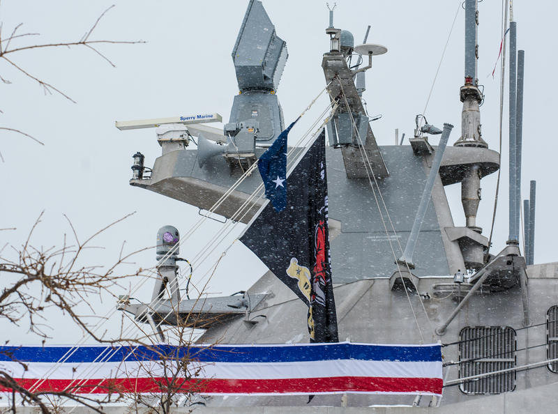 "The USS Little Rock's battle flag with its Warhawg mascot and motto ""Back With a Vengance"" are hoisted to the mast."