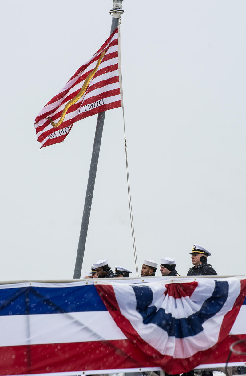 "Sailors aboard the new USS Little Rock hoist the First Navy Jack, commonly known as the ""Don't Tread On Me"" flag."