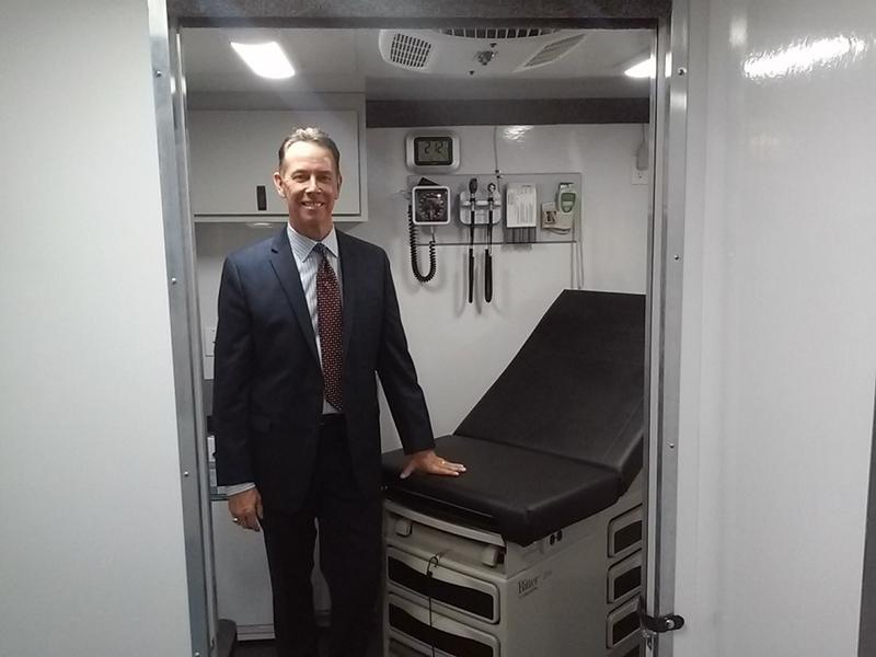Dr. Howard Hitzel, president and chief executive officer of BestSelf Behavioral Health, stands inside the clinical room inside one of the agency's new mobile addiction treatment units.