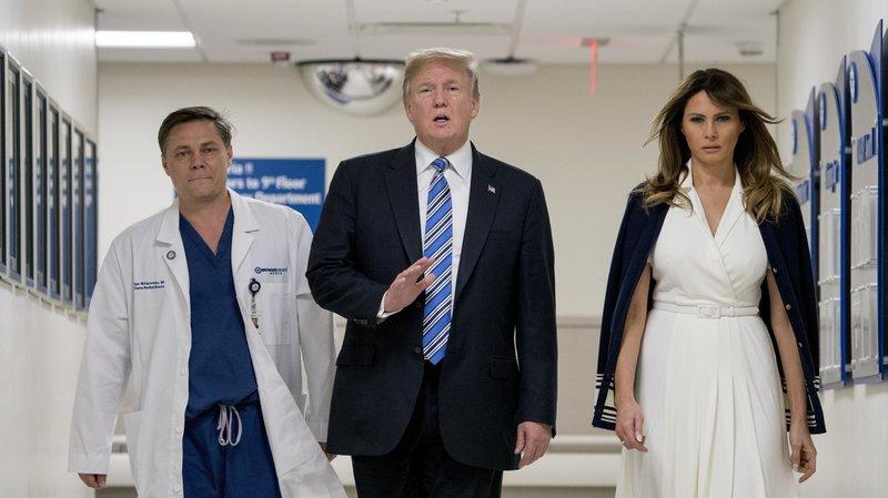 President Trump, accompanied by first lady Melania Trump and Dr. Igor Nichiporenko, speaks to reporters while visiting medical staff at Broward Health North in Pompano Beach, FL on Friday.