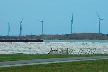 Wind turbines, like these in Lackawanna, would be built along Lake Ontario for Apex Clean Enregy's project.
