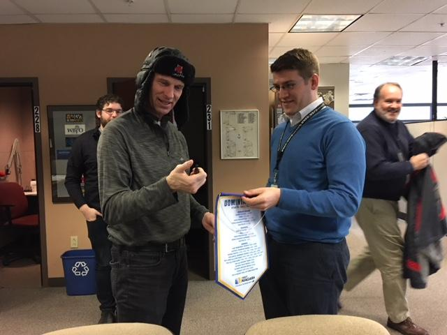Former Buffalo Sabres goalie signs autograph for WBFO's Avery Schneider