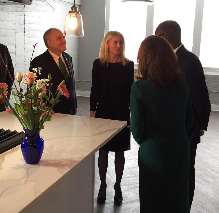 Amy Judd of Alexandre Apartments LLC (center) speaks with, left to right, New York State Comptroller Thomas DiNapoli, Lieutenant Governor Kathy Hochul and Buffalo Mayor Byron Brown, all of whom attended Friday's ribbon-cutting ceremony.