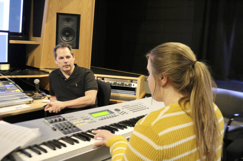Claire Bressette  playing the piano, working with producer Anthony Cassuccio