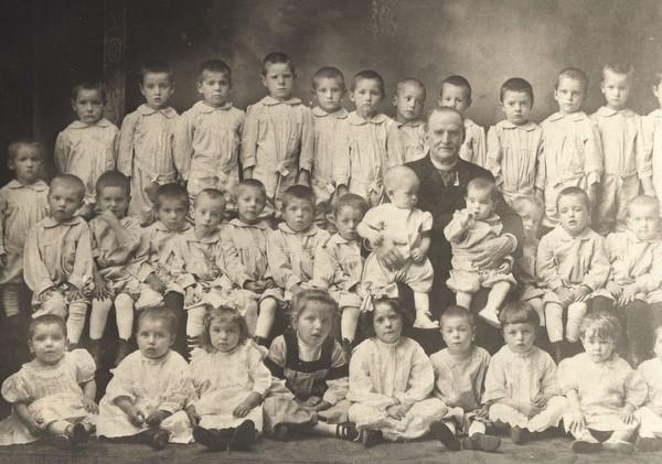 Father Nelson Baker with some of the many orphans he helped over his long tenure at Our Lady of Victory, funded in part by his seemingly inexplicable discovery of natural gas on parish property.