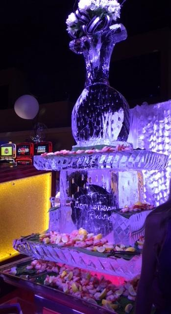 A Happy Birthday ice sculpture graces the party.