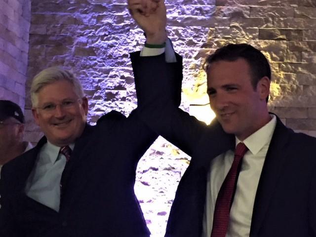 Michael Kearns (left) celebrates with state Assembly winner Erik Bohen.