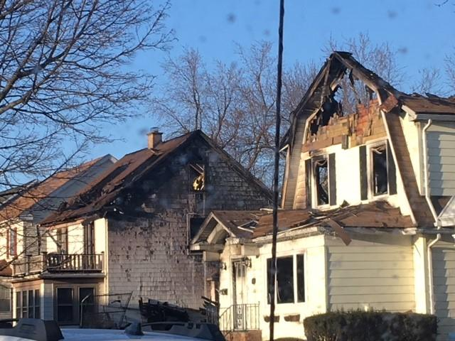 Two adjacent homes were damaged.