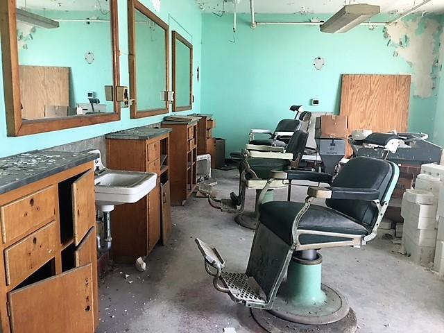 Former barber shop inside men's wing of old psych center.