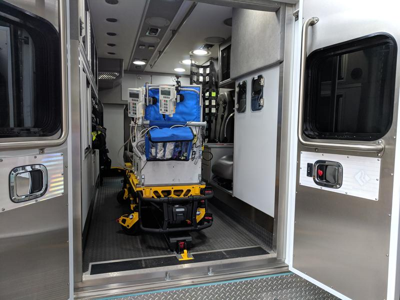 An isolette unit loaded into the back of the new neonatal transport vehicle
