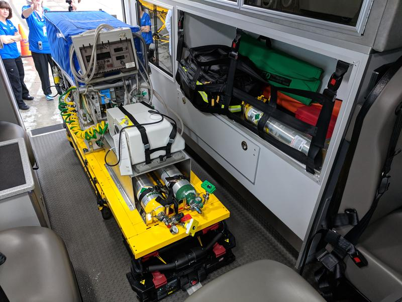 An isolette unit sits securely inside the neonatal transport vehicle