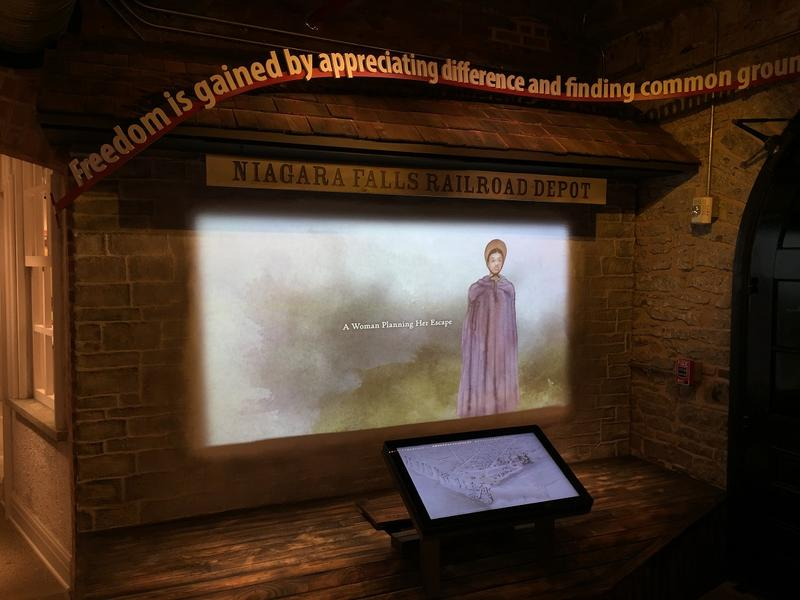 One of the numerous interactive stations where tales of escapees and the heroes who helped them are told.
