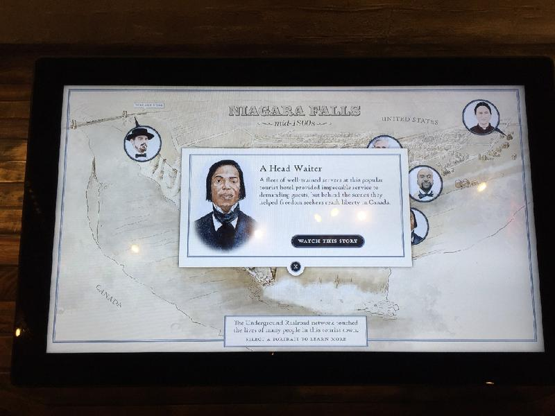 A monitor features John Morrison, the heat waiter at the Cataract House, where the all-African-American wait staff were among those who secretly helped escaped slaves cross into Canada and freedom.
