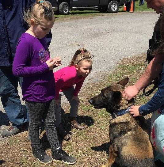 Buffalo Police K9 member Shield interacts with some youngsters prior to the announcement that the Police Department's K9 training center will be named in memory of the dog's late handler, Lieutenant Craig Lehner.