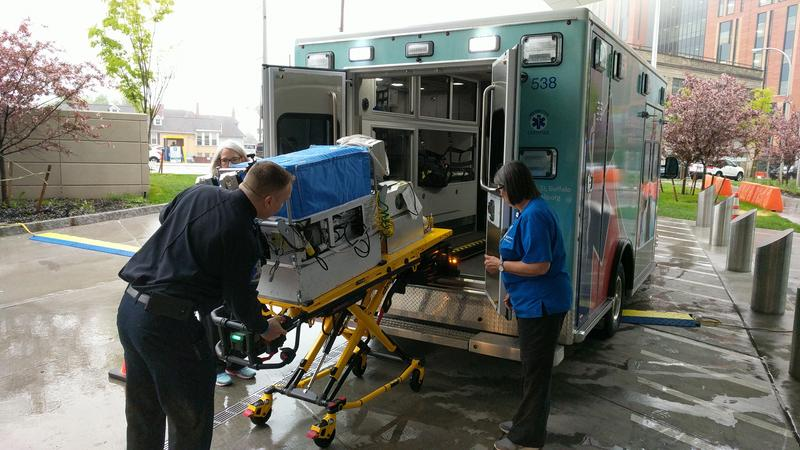 Scott Karaszewski loads an isolette unit into the new neonatal transport veihcle
