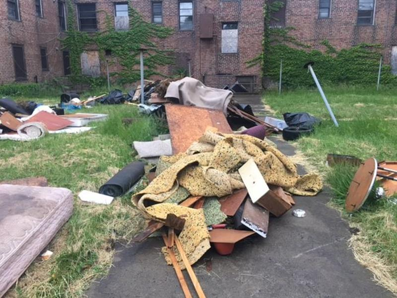 Trash is piling up at the abandoned Perry Homes complex