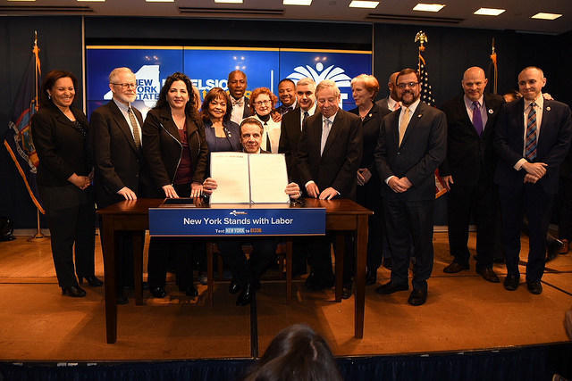 Gov. Andrew Cuomo signs a pro-union bill on April 12 in New York City.