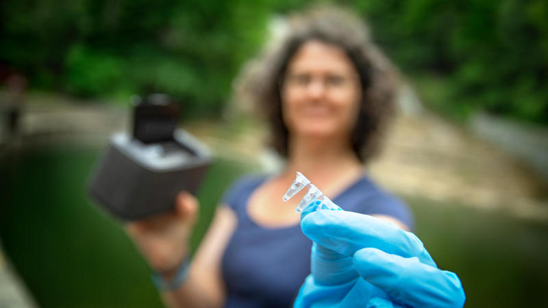 Ruth Richardson holds a water sampling device, part of a new test she and her team at Cornell are developing to speed detection of bacteria in the water at New York beaches.