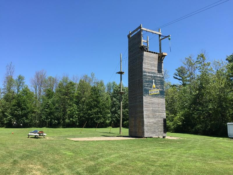 A rock wall and zip line tower on the grounds of Pioneer Camp in Angola, which hosts Operation Purple Camp.
