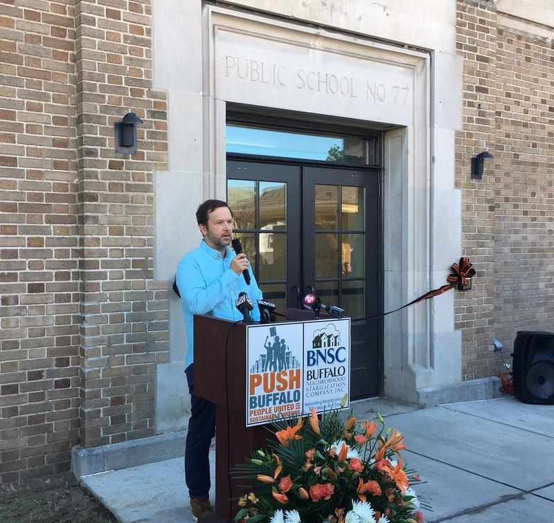 At reopening ceremony of School 77, outgoing PUSH Executive Director Aaron Bartley says the project will provide much-needed affordable housing.